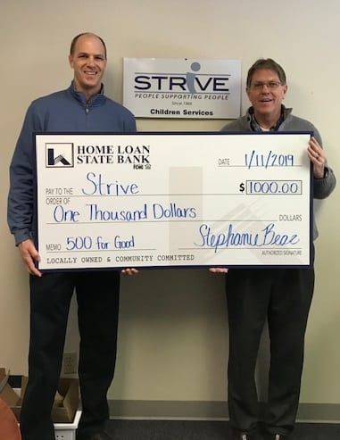 STRiVE received a check from our community partners Home Loan State Bank.