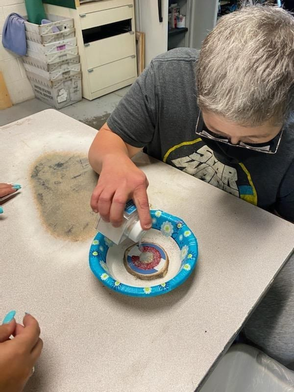 Disabled individuals create Christmas ornaments.